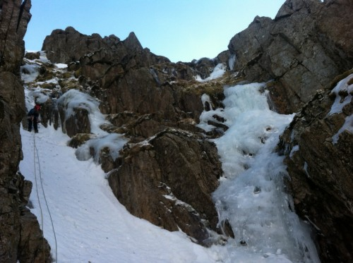Jamie starting out on the direct finish to Window Gully, with the Upper Icefall variant visible on right hand side.
