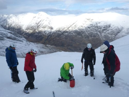 Checking snowpack stability on the winter skills course